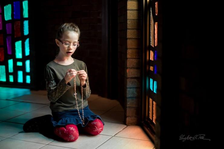 Child Praying the Rosary