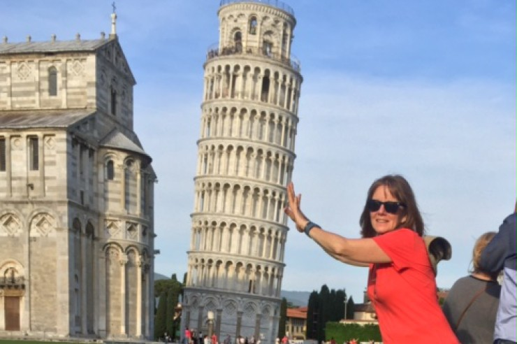 armstrong-holding-up-tower-pisa-featured-w740x493