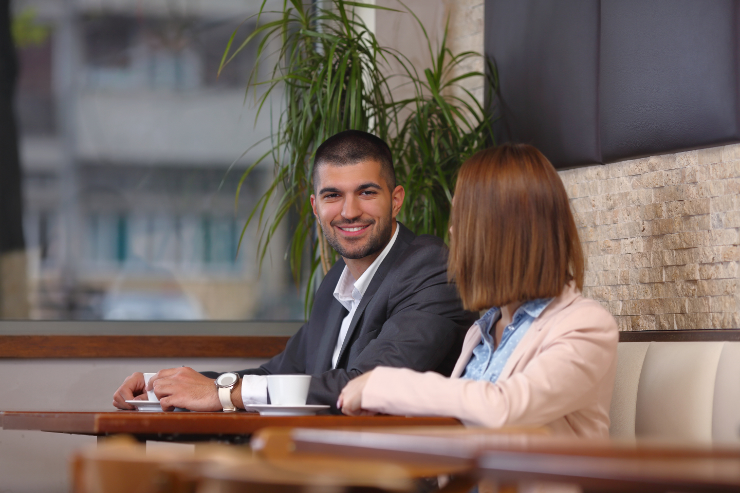 man-and-woman-business-meeting-coffee-featured-w740x493