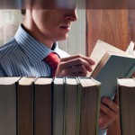 man-reading-in-library-featured-w740x493