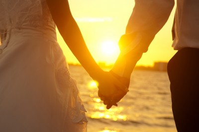 wife-and-husband-sunset-holding-hands-featured-w740x493