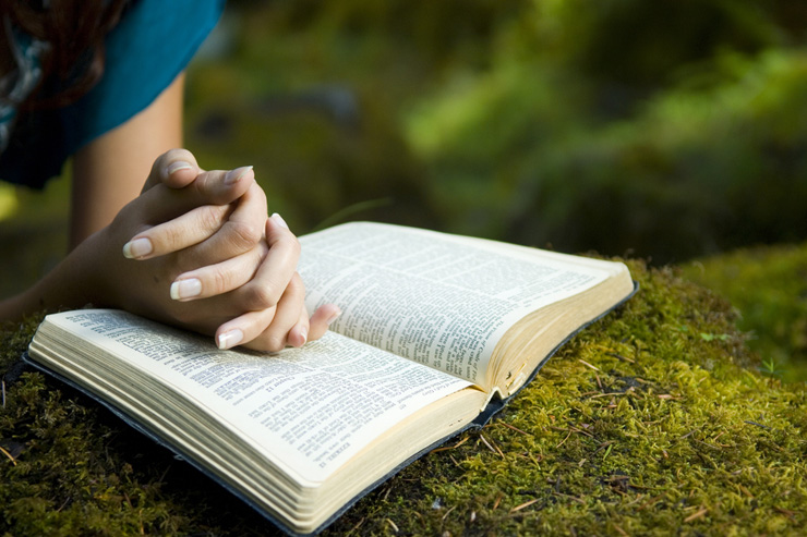 woman-praying-bible-featured-w740x493