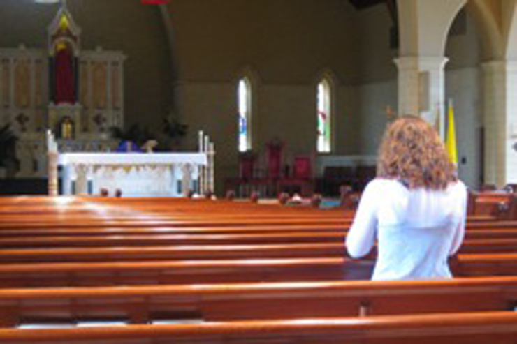 woman-praying-in-church-featured-w740x493