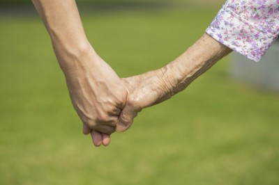 young-old-hands-together-featured-w740x493